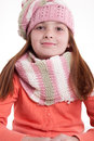 Young girl with pigtails in winter clothes smiling white background Stock Photos