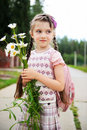 Young girl with pink bagpack ready for school Stock Photos