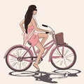 Young girl in pink goan riding bicycle realistic image of and listening to walkman Royalty Free Stock Image
