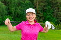 Young girl in a pink shirt and a white baseball cap Royalty Free Stock Photo