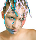 Young girl with plaits and geometrical makeup Royalty Free Stock Photo