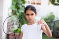 Young girl playing badminton Royalty Free Stock Photo