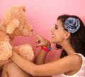 Young girl playing with big teddy bear at home Royalty Free Stock Photography