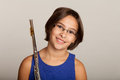 Young girl playing a flute in blue dress Stock Photos