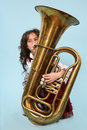 Young girl playing the horn Royalty Free Stock Photography