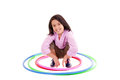 Young girl playing with hula hoop isolated over white background this image has attached release Royalty Free Stock Photography