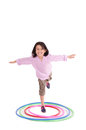Young girl playing with hula hoop isolated over white background this image has attached release Royalty Free Stock Image