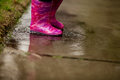 A young girl is playing in the much needed California rain. Royalty Free Stock Photo