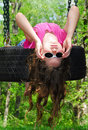 Young Girl Playing on Tire Swing Royalty Free Stock Photo