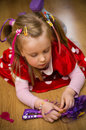 Young girl playing with toys portrait of a cute at home her on the floor Royalty Free Stock Image