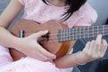girl playing ukulele Royalty Free Stock Photo