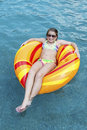 Young girl in pool on float while at resort vacation Royalty Free Stock Images