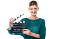 Young girl posing with clapperboard lights camera action holding Stock Photography