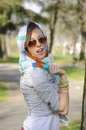 Young girl posing with a colorful bandana enjoying spring wearing and sunglasses Stock Photos