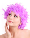 Young girl with purple wig from feathers Royalty Free Stock Photo