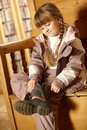 Young Girl Putting On Warm Outdoor Clothes Royalty Free Stock Photo