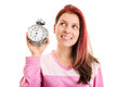 Young girl in pyjamas up on time look look im holding an alarm clock isolate white background Stock Photos