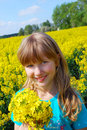 Young girl in rape field Royalty Free Stock Photos