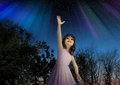 Young Girl Reaching for the Stars in Hope Royalty Free Stock Photo