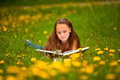 Young girl reading a book Stock Image