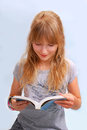 Young girl reading a book beautiful and learning to the exams Stock Image