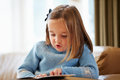 Young girl reading story at home cute Royalty Free Stock Images