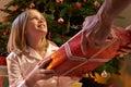 Young Girl Receiving Christmas...