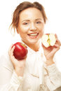 Young girl with a red apple in hand portrait of lovely over white background Royalty Free Stock Photo