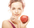 Young girl with a red apple in hand portrait of lovely over white background Stock Photos