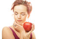 Young girl with a red apple in hand portrait of lovely over white background Royalty Free Stock Image