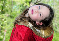 Young Girl in Red Cape Royalty Free Stock Images
