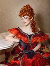 Young girl red dress attractive and wig courtesan Stock Photography