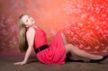 Young girl in red dress pose in studio Royalty Free Stock Photo