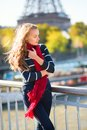 Young girl in red scarf on a fall day in paris beautiful Royalty Free Stock Image