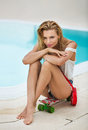 Young girl relaxing on the pool. Royalty Free Stock Photo