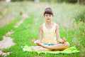 Young girl relaxing while sitting in lotus position. Royalty Free Stock Photo