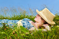 Young girl resting in meadow Stock Photos