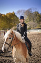 Young girl riding horse portrait of teenage outdoors on sunny autumn day Royalty Free Stock Photography