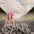 Young girl on a road ready to run Royalty Free Stock Photo