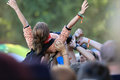 Young girl at a rock concert carried by the crowd over their heads festival jarocin poland Royalty Free Stock Photos