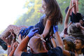 Young girl at a rock concert carried by the crowd over their heads security service helps her get out of the crowd festival Royalty Free Stock Images