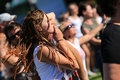 Young girl at a rock concert in long hair braided in cornrows dancing and smoking cigarette festival jarocin poland Stock Image