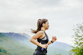Young girl runner with energy nutrient gel in hand running Royalty Free Stock Photo