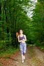 Young girl runner in the forest pretty Stock Photography