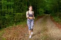Young girl runner in the forest pretty Royalty Free Stock Image