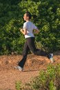 Young girl runner on the springtime on the forest road Royalty Free Stock Photo