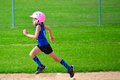 Young Girl Running Bases in Softball Royalty Free Stock Photo