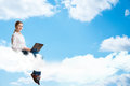 Young girl running in the clouds with a laptop place for text Royalty Free Stock Photo