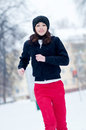 Young girl running on a cold winter day Stock Photo