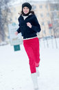 Young girl running on a cold winter day Royalty Free Stock Image